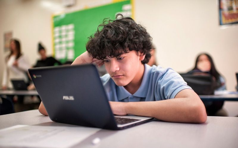 student focusing on computer